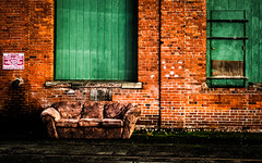 no parking (Steven Schnoor) Tags: signs color brick wall canon alley colorful bricks tracks couch sofa washingtonstate 2012 chehalis schnoor simplelogic 10december coveredwindows