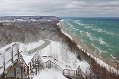 """Inspiration Point""  Bluff overlooking Lake Michigan and the little town of Arcadia, Michigan (Michigan Nut) Tags: winter sky snow clouds stairs forest landscape waves michigan hill scenic landmark lakemichigan overlook bluff arcadiabluffs arcadiamichigan trinitylutheranchurch johnmccormick michigannutphotography inspiratonpoint"