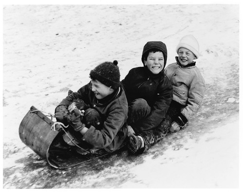 Boys on tobogan from Minnesota Historical Society in Wishing for a Snow Day by Peg Meier