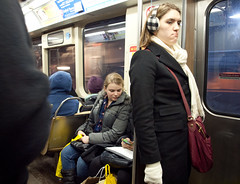 Restrained moderns rocking the ear muffs (TheeErin) Tags: winter people chicago motion cold window standing train subway illinois women cta authority el passengers transit rails l earmuffs grumpy armitage brownline chicagoland grumpycat chicagotransitauthority chicagoist ridership masstrans
