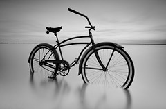 Melting (Alan Drake) Tags: longexposure light sea sky blackandwhite bw seascape canada black water bike bicycle clouds digital landscape nikon rust dusk britishcolumbia smooth schwinn d7000 49schwinn