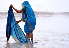 The Woman in Blue (pallab seth) Tags: morning sea india colour reflection festival religious nikon religion culture delta fair ritual tradition custom devotee hindu hinduism bengal pilgrimage pilgrim ganga 2012 ganges mela bayofbengal sunworship gangasagar holydip womaninblue gangasagarmela tamronaf70300mmf456dildmacrolens pallabsethsagar