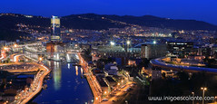 Bilbao panormica al atardecer (Iigo Escalante) Tags: new city blue sunset espaa orange tower azul river de atardecer lights luces spain san long exposure torre iigo vieja feria ciudad center panoramic exhibition bilbao antigua national hour hora panoramica planet works conde lonely naranja bizkaia ria geographic nuevo vizcaya escalante bilbo nast exposicion fotografo larga barakaldo obras traveler muestras nervion iberdrola ibaizabal mames