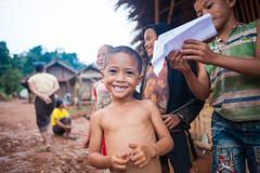Laos Village (Pha Pon Golden Mountains) (ctanner999) Tags: people smiling kids zeiss paper children village airplanes dirt carl laos manualfocus pha pon ze luang prabang laotian 5dmarkii canon5dmarkii distagont225 zeisscontest2012 zeiss25mmf2 zeiss25mmf20 zeiss25mmf2ze zeissdistagont225 zeisscontest2012