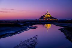 Purple Sunset (dawvon) Tags: world travel sunset france castle colors architecture night reflections dark landscape ed twilight nikon europe purple nightshot zoom unescoworldheritagesite unesco worldheritagesite clear mount unitednations normandie stmichel nikkor normandy f28 vr afs montstmichel montsaintmichel lenses historicalbuilding zoomlens 70200mm telezoom unitednationseducationalscientificandculturalorganization bassenormandie  f28g fmount vibrationreduction vr2 28g vrii telephotozoom  lowernormandy abbayedumontsaintmichel abbeyofmontsaintmichel nanocrystalcoat telephotolen afsnikkor70200mmf28gedvrii 70200mmf28gvrii  midtelephotozoom