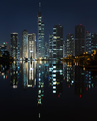JLT in the mirror (momentaryawe.com) Tags: lake glass buildings reflections lights evening dubai uae middleeast bluehour unitedarabemirates jlt jumeirahlaketowers jumeirahislands almastower catalinmarin momentaryawecom