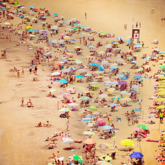 Homesick (Mara T Pons) Tags: summer people espaa beach spain shore tiny umbrellas canaryislands islascanarias sanagustn verano2012