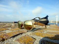 Getting Dressed (Quetzalcoatl002) Tags: dressingup sunglasses sandal shoes sandy beach sky reflection