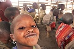 Maasai - Tanzania - Africa (TLMELO) Tags: tanzania kid boy child criança menino portrait africa masai tribe tribo serengeti poor pobre angry bravo boring kilimanjaro african africano africana retrato mount kilimanjaromount friends brothers mom son baby maasai woman hat women