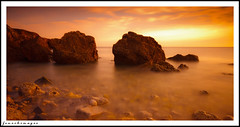 Burning shore... (EosKid) Tags: shore coast coastline beach bay sea seaside rocks dawn sunrise morning water tide pebbles sunlight intense horizon erosion seascape landscape peterfenech eoskid