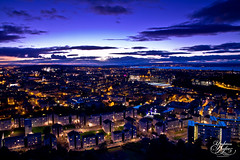 Edinburgh (Paki Nuttah) Tags: city uk blue houses light sunset urban house architecture night dark landscape lights scotland twilight edinburgh europe cityscape hour gb salisbury crag spiritofphotography flickrtravelaward