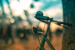 meet you by the ferris wheel (~mimo~) Tags: light sunset sky blur color tree bike bicycle germany photography bokeh ferriswheel cheerful duesseldorf hcs mimokhair