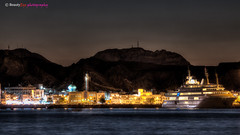 Muscat - Sultan Qaboos Port [7 Raw HDR] (Beauty Eye) Tags: longexposure nightphotography mountain seascape building architecture night photoshop canon dark eos rebel seascapes nightshot outdoor royal sigma scene 70300mm oman muscat souq hdr t3i mutrah matrah cameraraw phototype beautyeye apomacro sigma70300mmf456apomacro  canon600d sultanqaboosport rebelt3i kissx5 canon600deos muscatsultanqabooscornich omanomancountry