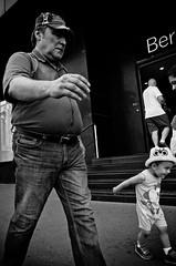 Just Like Dad (stimpsonjake) Tags: nikoncoolpixa 185mm streetphotography bucharest romania city candid blackandwhite bw monochrome father son dad