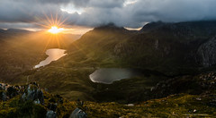 Ogwen Valley Sunrise (C Noakes) Tags: sunstar landscape photography ogwen north wales snowdonia national park light morning sunrise cwm idwal llyn sun shine flare lake view mountain vista rocks foreground cloud storm nikon d7000 tokina 1224 12mm wild camp wide angle
