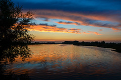 Sunset (Jaco Verheul) Tags: sun sunset water sky colour orange blue purple cloud clouds cloudporn reflection tree silhouet nikon nikond7100 d7100 1685mm jacoverheul thenetherlands holland tiendgorzen outdoor nature ngc landscape waterscape dusk