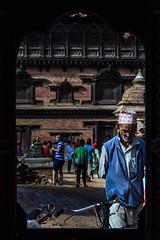 The Old Man's Walk (kevinmaharjan) Tags: old man bhaktapur nepal artectiture city people portrait walk framing naturalframing nikon nikkor photography kevinmaharjan