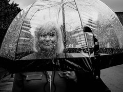 rain L1000624 (rafhuggins) Tags: london rain hackney umbrella weather see through lady leica m240