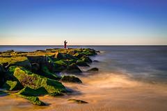Fisherman (Firoz Ansari) Tags: longexposure sea ocean capemay fisherman rock nj newjersey