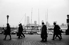 The End (photo.allen) Tags: leica newyork docks buildings boats kodak trix summicron batterypark pedestrians m6 commuters 352