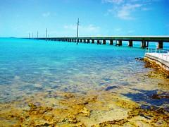 Miami Long Bridge (Tim Denzler) Tags: ocean bridge blue sky orange sun water florida miami horizon clear