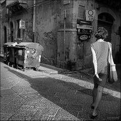 Z.T.L. (much0) Tags: street light shadow bw woman contrast donna stripes ombra streetphotography bn frombehind luce overtheshoulder contrasto strisce dispalle much0 darktable