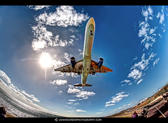 Landing Approach Fisheyed (Edwinjones) Tags: pictures ocean light sun color colour beach water clouds plane airplane landscape photography flying photo airport wings spain photos airc