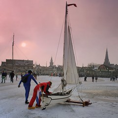 Ice yachting boat arriving in the harbor of Monnickendam (B℮n) Tags: winter sun sunlight cold holland ice netherlands topf50 iceskating skating thenetherlands wintertime marken speedskaters waterland monnickendam frozensea markermeer historicalmoment naturalice 50faves coldwave gouwzee seaofice schaatsfeest schaatstocht ijszeilen dutchskaters gouwsea iceskatingtomarken historischeijstocht 12cmdik groteijsoppervlakte schaatsweekend ijszeiler iceyachting skateoutdoors dutchskatejourney iceinthenetherlands hollandlovesice dichtbevroren 12cmdikijs infiniteseaofice 12cmthickice monnickendammarkenvolendam iceskatingonthegouwsea