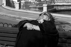 Fat lady sunbathing..Malta (Don Jackson) Tags: life street portrait people urban bw woman sun abstract art strange face lady female digital canon outside eos glasses weird amazing hands women funny hand dress arms body pavement expression seat fat relaxing thoughtful photojournalism documentary surreal sunny social malta karma unusual ha bazaar bathing chin journalism obese global voluptuous