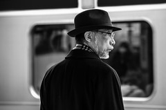 Waiting for the train (marlonw) Tags: bw japan blackwhite candid streetphotography   exif:focal_length=135mm exif:make=pentax camera:make=pentax smcpentaxda50135mmf28edifsdm exif:iso_speed=1250 geo:countrys=japan  exif:aperture=40 exif:lens=smcpentaxda50135mmf28edifsdm camera:model=pentaxk5 exif:model=pentaxk5