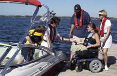 People boarding a boat (StateMaryland) Tags: life people ski water wheel landscape pier boat chair wheelchair jacket boating lifejacket disability