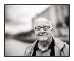 Tom Walsh, BEM (Gary Rowlands) Tags: hasselblad 110mmfe pentax67 fujiacros100 hc110 salfordquays cigar smoker britishempiremedal bem portrait bw monochrome film 110mm male oap zeiss planar f20 spectacles booked manchester faces 848 imacon scanner streetportrait stranger mf mediumformat analogue silver