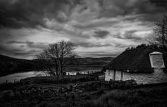 Skye cottage (cliveg004) Tags: skye cottage isleofskye lochainort scotand traditional sky clouds loch highlands bw blackandwhite monochrome mono drama dramatic