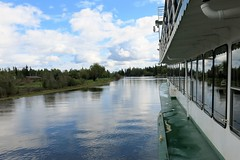 riverboating on the Chena River (karma (Karen)) Tags: chenariver alaska riverboating rivers boats windows reflections clouds