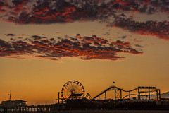 Santa Monica Pier Amusement Park 2011 (Patrick Gregerson) Tags: 2011 california santamonica beach people vacation sunset sky outside outdoor dusk clouds ferriswheel amusementpark pier canonrebelxti rollercoaster pacificocean red orange summer evening