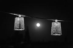 the moon is a lightbulb breaking (timsnell) Tags: marrakech marrakechtensiftalhaouz morocco africa blackandwhite dark fullmoon marrakesh nomad lampshade light lightbulb medina moon restaurant souk