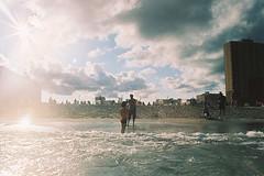 Afternoon silhouettes (andrewkatchen) Tags: asburypark newjersey jerseyshore beach ocean nikon film 35mm portra400 n6006