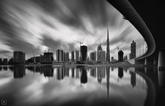 Inception... (Charlie_Joe) Tags: uae dubai burjkhalifa tallest skyscraper skyline cityscape architecture unitedarabemirates sunset cloudscape evening reflection downtown silhouette bridge businessbay longexposure bw blackwhite monochrome leefilters bigstopper sharp curve inception outdoor building