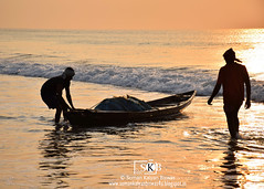 A Moment From the  Returning of the Fishermen after Fishing All Night Long (Suman Kalyan Biswas) Tags: portraiture silhouette portraitureinmotion fishermen fishermenreturninghome beach puri outdoor puriseabeach odisha india bayofbengal morning daybreak touristspot indianpopularbeach boat sea photography livelihood profession walksoflife puribeach