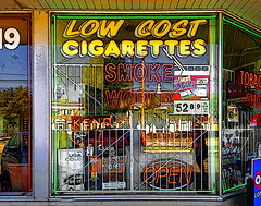 Smoke em if you got em  life is short. (SteveMather) Tags: iphone 6s procamera vividhdr smoke tobacco shop neon window sign signage lines tooncamera clutter crowded