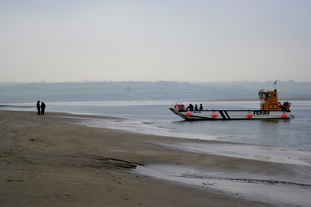 Couple and Ferry on Daymer Bay, (Cornwall, UK)