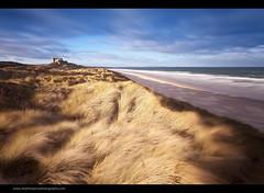 Passing Wind (Steve-P2010) Tags: longexposure sea castle clouds coast daylight windy northumberland coastal le daytime lowtide bamburgh daytimelongexposure