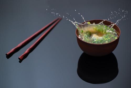 Dropped Tofu (torode) reflection green japanese soup miso mess flash tofu chopsticks wabisabi splash beancurd dropped leeks highspeed strobe negi disturbance sudden