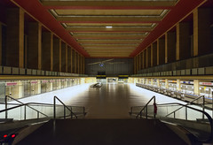 """""""Sie steigen in den Hauptbahnhof ein"""" (tonal decay) Tags: light red berlin rot deutschland licht airport gate air terminal bourbon halle tempelhof rolltreppe"""