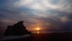 Pen del Cuervo (Guilleont) Tags: sunset espaa costa sol beach rock sunrise atardecer dawn andaluca spain playa amanecer crow dust andalusia puesta palo mlaga cuervo orto pen