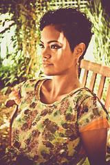 Mariana III (From.Saints) Tags: november flowers trees summer brazil portrait orange brown sun green texture girl beautiful fashion yellow brasil garden bench hair gold golden eyes dress purple makeup sunny curly short editorial romantic shorthair earrings brunette eyeshadow sequins spark curlyhair 2011 undercut
