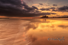 Bamburgh Castle - Boxing day 2011 (Mike Ridley.) Tags: uk sea england sunlight seascape colour beach water sunshine clouds sunrise canon landscape photography dawn coast waves shoreline northumberland coastal coastline canon1740mmf4lusm northeastcoast bamburghcastle mikeridley canon5dmkll fellwalker1