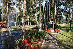 Daytona Memorial Gardens (Chris C. Crowley) Tags: trees fountain palms pond shadows scenic peaceful graves swans serene daytonabeachflorida bellevueave chriscrowley celticsong22 daytonamemorialgardens lohmansfuneralhome lohmanscemetery
