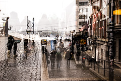 Cold Cold Ground (petertandlund) Tags: street city people urban color rain sweden stockholm sdermalm doubleexposure gray streetphotography slussen sthlm multiexposure pavingstones