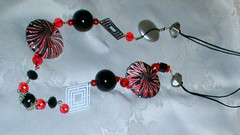 Black and Red, swirling once again (klio1961) Tags: necklace handmade spirals bijou jewellery polymerclay fimo clay spinning faux sculpey swirls sparkling swirly shimmering cernit pendants abalorios joyas premo focalbeads